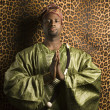 Man wearing African clothing. - Stock Photo
