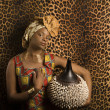 Young African American Woman in Traditional African Dress — Stock Photo #9330423
