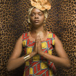 Young African American Woman Praying and Wearing Traditional African Dress — Stock Photo #9330427