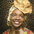 Smiling Young African American Woman in Traditional African Dress — Stock Photo #9330429