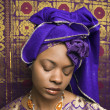 Young African American Woman in Traditional African Dress With Eyes Closed - Stock Photo