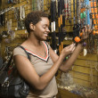 Young African American Woman Shopping For Jewelry - Stockfoto