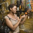 Young African American Woman Shopping For Jewelry - Stok fotoğraf