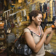 Stock Photo: Young AfricAmericWomShopping For Jewelry