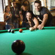 Group playing billiards. — Stock Photo