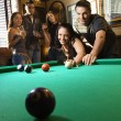 Stock Photo: Group playing billiards.