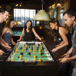 Stock Photo: Group of Playing Foosball