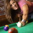 Young Woman Playing Billiards - Stock Photo