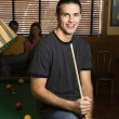 Man sitting on pool table. — Stock Photo