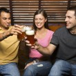 Three Friends Toasting With Beers - Stock Photo