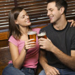 Couple Toasting Their Beers — Stock Photo #9330518