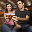 Couple Toasting Their Beers — Stock Photo