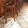 Royalty-Free Stock Photo: Bar stools at bar.