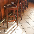 Stock Photo: Bar stools at bar.