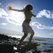 Woman jumping on beach — Stock Photo
