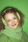 Woman wearing earmuffs. — Stock Photo