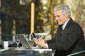 Businessman sitting outdoors. — Stock Photo