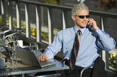 Businessman on cellphone. — Stock Photo