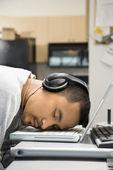 Man sleeping on laptop. — Stock Photo