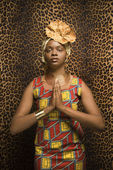 Young African American Woman Praying and Wearing Traditional African Dress — Stockfoto