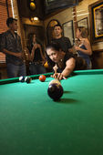 Woman shooting pool. — Stock Photo