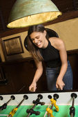 Young woman playing foosball. — Stock Photo
