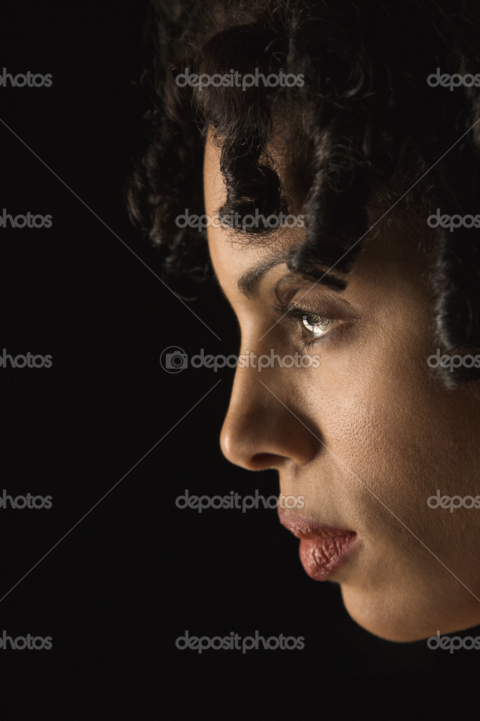 Profile of mid adult Hispanic woman with curly hair. — Stock Photo #9330226