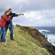 Stock Photo: Couple using camera.