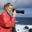 Woman with camera. — Stock Photo