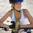 Young woman bicycling. - Stock Photo
