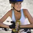 Royalty-Free Stock Photo: Young woman bicycling.