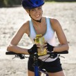Young woman biking. - 