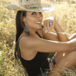 Pretty woman in field. - Stock Photo