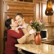 Happy couple in kitchen. — Stock Photo