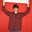 Boy holding blank sign. — Stock Photo