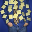 Boy covered with sticky notes. — Stock Photo