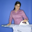 Teen girl ironing shirt. — Stock Photo #9364180