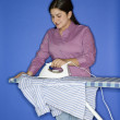 Teenage girl ironing shirt. — Stock Photo #9364181