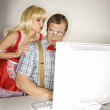 Nerd and maid with computer. — Stock Photo