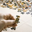 Hand with puzzle pieces. - Stock Photo