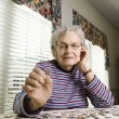 Elderly Woman Doing Jig Saw Puzzle — Stock Photo #9364286