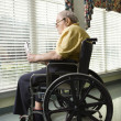 Elderly Man in Wheelchair - Stock Photo