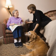 Foto de Stock  : Elderly Woman With Younger Woman and Dog