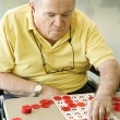 Mature Caucasian playing bingo. — Stock Photo
