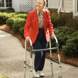 Elderly WomUsing Walker — Stock Photo #9364359