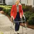 Elderly Woman Using Walker - Stock Photo