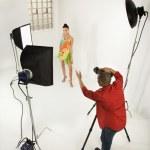 Man photographing pretty female model. — Stock Photo