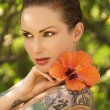 Tattoed woman with flowers. — Stock Photo #9364673