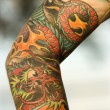 Tattooed arm. - Stock Photo