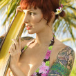 Tattooed woman in bikini. - Stock Photo